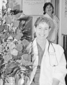 """Med-Surge/Charge Nurse Frances Soward in 1992 with Herminia """"Minnie"""" Rodriguez in the background. FRANCES SOWARD   COURTESY PHOTO"""