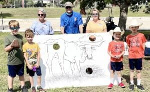The Pleasanton Rotary Club's Cow Patty Bingo to raise funds for scholarships was a huge success. Rotarians, while selling tickets, had a fun Cow Patty Toss with artwork by internationally famous artist and Rotarian Lee Ricks, Jr. Pictured, from left: Robert Tom, Ryan Tom, Melissa Dupée, James Warnken, Jessica Tom, Parker Leach and Pierce Leach. Parker and Pierce are the sons of Rotarian and Parks & Rec Director Greg Leach. NOEL WILKERSON HOLMES | PLEASANTON EXPRESS