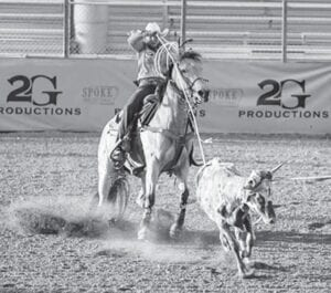 Rylie Smith ropes the heels of a calf during a rodeo in 2020. Smith, a freshman at Southwest Texas Junior College in Uvalde, has been red-hot during the 2020-2021 and looks to keep that streak going at the CNFR. COURTESY PHOTO