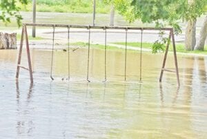Left: The old playground swing set at the Pleasanton River Park on June 4. Right: Atascosa River at the Texas 242 bridge on June 4 on the north side of the Pleasanton River Park near the Pleasanton Country Club.