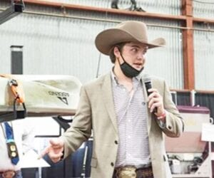 Tristan Kurz giving a sales pitch to buyers at the San Antonio Ag Mechanics Sale. His team's kayak trailer later sold at the live auction for $15,000. COURTESY PHOTO