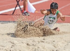 Juan Lopez sticks the landing in long jump at the Region IV-4A meet at Javelina Stadium in Kingsville on April 24. He was one of six Eagles to compete at regionals. Pleasanton also sent six athletes to the state meet. SAM FOWLER   PLEASANTON EXPRESS