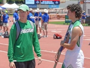 Pleasanton pole vault coach Daryl Rentfro (left) and freshman Preston Pilgrim discus strategy at the Class 4A state meet on May 6. Pilgrim went on to finish fourth in the event with what was a PR height of 14-0. SAM FOWLER   PLEASANTON EXPRESS