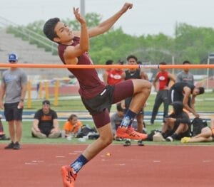 Noah Gonzales attempts to clear the bar at the area meet in Poth on April 14. Gonzales' jump of 6-0 won the district title and advanced him to regionals. PLEASANTON EXPRESS FILE PHOTO