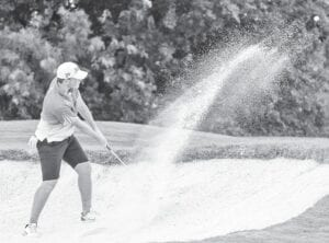 Pleasanton senior Travis Garcia hits out of the sand during the Class 4A state golf tournament on May 11. PLEASANTON EXPRESS FILE PHOTO