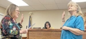 Candace Cantu, right, is sworn into office as the Place 2 council member by City Secretary Kerry McCollough during the July 6 meeting. DIANA GUTHRIE | PLEASANTON EXPRESS