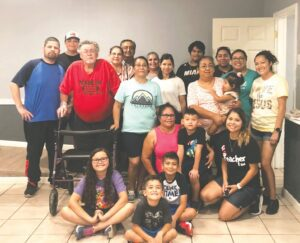 Members of the El Calvario church helped package and cook meals to hand out to those in the community who stopped by to pick up plates. Pictured are, from left: Hector Brown, Hector Brown Jr., Pastor Ricardo Garcia, Mary Rico, Jose Montoya and Danya Rodriguez; middle row- Samuel Latham, Martha Garcia, Glenda Garcia, Leticia Hermosillo, Zaryana Hermosillo, Mayra Brown and Martha Gonzalez; kneeling Carmen Barahona, Ricardo Garcia, Sophia Brown, Liam Gonzalez and Adan Gonzalez. GABRIELLA RUIZ   PLEASANTON EXPRESS