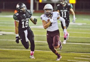 Poteet's Martin Ibarra races past a Marion defender in 2020. The Aggies brought home the highest ranking of area teams in the 2021 summer edition of Dave Campbell's Texas Football magazine. PLEASANTON EXPRESS FILE PHOTO