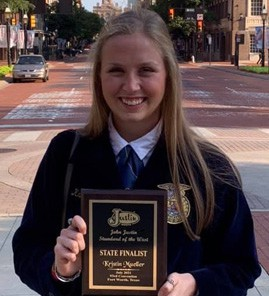 """Kristin Mueller, receives the John Justin """"Standard of the West"""" award including a plaque, product certificate and $500 Scholarship."""