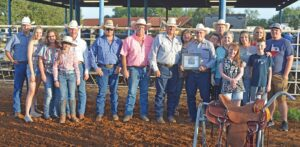 """William """"Ernie"""" Bandy was inducted into the South Texas Cowboy Hall of Fame Saturday night during the Pleasanton Young Farmers' Rodeo and Festival at the Atascosa County Show Barn. Pictured, from left, are Rick Gray, Kyndall Robinson, Shana Henry, Abby Henry, Craig Henry, Derek Ashley, Randy Rice, Darryl Ashley, Laura Marsh, Ernie Bandy, Zane Gray, David Bandy, Mary Bandy, Maddie Nowell, Amy Gray, Lisa Nowell, Garret Robinson and Samuel Gray. Not pictured are Bandy's youngest daughter Krista Bandy Morales and her family of Florida. JOE DAVID CORDOVA   PLEASANTON EXPRESS"""