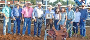 Robert May was inducted into the South Texas Cowboy Hall of Fame Saturday night during the Pleasanton Young Farmers' Rodeo and Festival at the Atascosa County Show Barn. Pictured, from left, are Gus Wheeler of Atascosa County Livestock Exchange and saddle sponsor, Derek Ashley, Randy Rice, Darryl Ashley, Hall of Famer Robert May, daughter Marie Smith, son-in-law Brandon Smith, grandchildren Emma and Aydan Smith and Ann Smith and David Smith. JOE DAVID CORDOVA   PLEASANTON EXPRESS