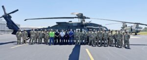 Fort Bliss troops pictured in front of a Black Hawk at Pleasanton Municipal Airport on the afternoon of Aug. 31 alongside City of Pleasanton staff from the airport and fire department. Airport staff was able to receive assistance from the Pleasanton Fire Department and Pleasanton's Office of Emergency Management to get the crew members settled into hotels while they await further orders. CADE ANDREWS   PLEASANTON EXPRESS