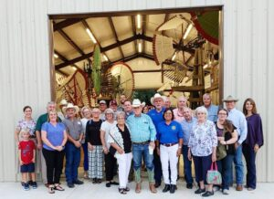 Jim Collums, center, in long-sleeve shirt and cowboy hat, was the guest speaker at the Pleasanton Rotary Club Social at the Longhorn Museum. GREG LEACH | COURTESY PHOTOS