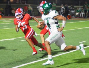 Pleasanton's Joel Arevalo (4) tries to run for open field while Jourdanton's Jonathan Castillo (5) tries to get in position to make a stop during the contest between the Eagles and Indians on Friday in Jourdanton. See page 3B for more photos from Friday's game JOE DAVID CORDOVA   PLEASANTON EXPRESS