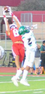 Right: Jourdanton's Luke Tapp (8) catches a pass that's out of reach for Pleasanton's RJ Franco (5).