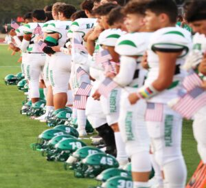 Above: The Pleasanton Eagles also held miniature American flags during the national anthem before the game. TAMMY SHANNON   PLEASANTON EXPRESS
