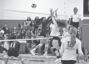 Poteet and Jourdanton battle at the net during the game last Tuesday night in Indian Gym. Jourdanton won the game in four sets. Since the start of 2010 the two schools have played 14 times and each has won seven times. JOE DAVID CORDOVA | PLEASANTON EXPRESS