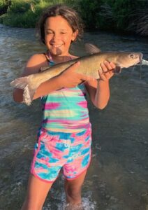 Pictured are 5th grader Sophia Velasquez and 10th grader Isabel Velasquez, daughters of JJ and Corinna Velasquez of Jourdanton. Sophia is holding a fish she caught at South Llano River this summer. Isabel is kneeling with a hog she shot with her Bear Compound Bow on the property of family friend Betty Rackly in Pleasanton. JJ VELASQUEZ | COURTESY PHOTOS