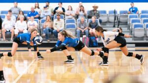 McMullen County's Rylee Stendebach goes for a dig while teammates Jayden Jones (L) and Alexis Ortiz (R) look on during last Tuesday's game. J GARCIA | PLEASANTON EXPRESS