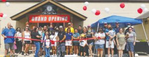 Dozens attended the ribbon cutting ceremony to celebrate the grand opening of the Tat Studio on Oct. 3. The new shop is located at 1342 W. Goodwin St. in Pleasanton. CADE ANDREWS   PLEASANTON EXPRESS