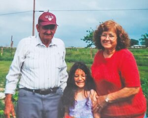 Ava Luna, center, is pictured in 2001 at the strawberry farm with her great-grandparents, Dolores and Corina Garcia of Poteet. DIANE GARCIA | COURTESY PHOTOS