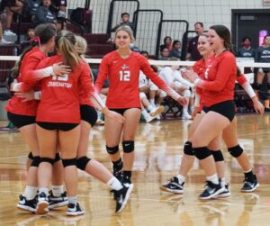 The Jourdanton Squaws celebrate after beating the Poteet Lady Aggies last Friday night. CADE ANDREWS| PLEASANTON EXPRESS