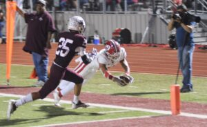 Jourdanton's Luke Tapp dives for the end zone during the game against Poteet last Friday night at Aggie Stadium. The Indians fell short, 27-25, in a game with first place in the district on the line. JOE DAVID CORDOVA   PLEASANTON EXPRESS