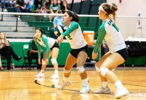 Pleasanton's Anai Romo (2) goes for a dig during a recent game while teammates Mary Martinez (5) and Victoria Urbanczyk (10) look on. J GARCIA | PLEASANTON EXPRESS