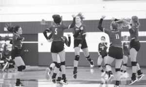 The McMullen Cowgirls celebrate scoring a point during their first meeting with Charlotte on Sept. 21. Last Friday the Cowgirls completed the season sweep with a four set victory over the Trojanettes in Charlotte. McMullen County currently holds the fourth playoff spot in district with two weeks remaining in the regular season. J GARCIA | PLEASANTON EXPRESS