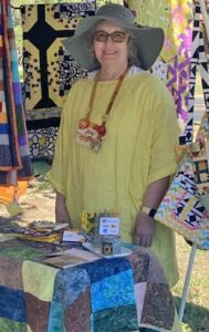 """Joy Gunter is set up at her """"Quilts & More"""" booth at the Maker's Market on Oct. 9. You can catch her and many other vendors again this Saturday. MELISSA THEIS 
